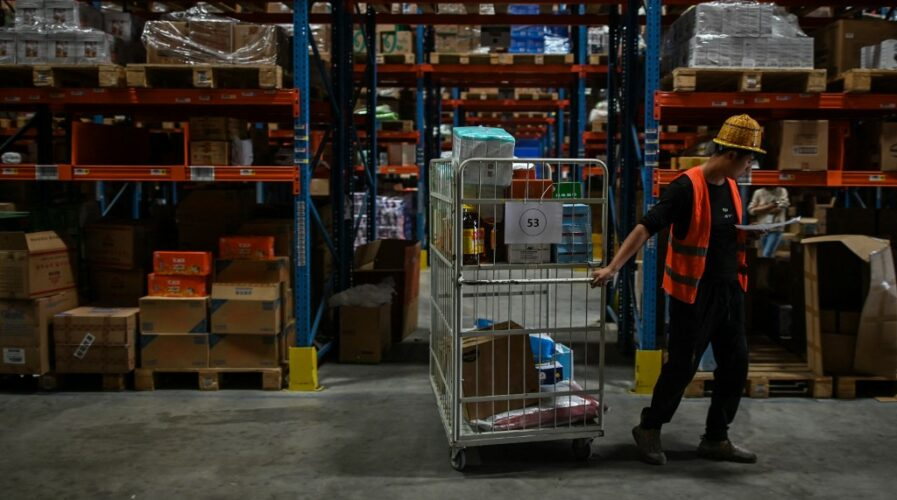 E-commerce events such as Singles' Day is hugely popular in SEA - but logistics players are struggling to keep up with consumer demand. (Photo by Hector RETAMAL / AFP)
