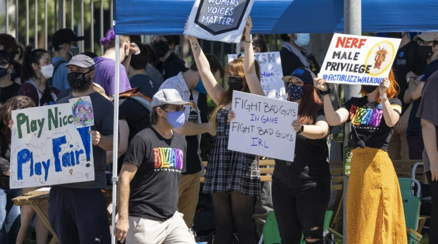 Employees of the video game company, Activision Blizzard, hold a walkout and protest rally to denounce the company's response to a California Department of Fair Employment and Housing lawsuit and to call for changes in conditions for women and other marginalized groups, in , in Irvine, California, on July 28, 2021. (Photo by DAVID MCNEW / AFP)