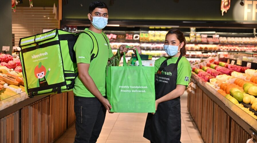 e-grocery platform HappyFresh and their delivery rider and shopper