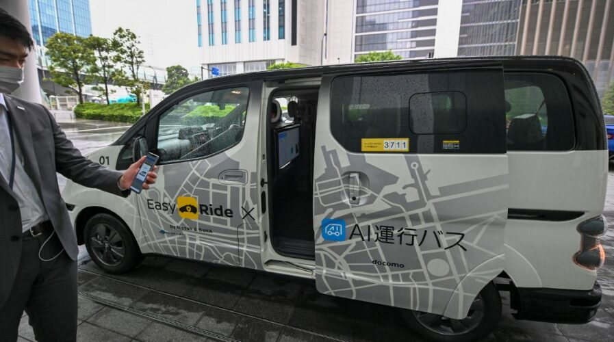 This picture taken on September 9, 2021 shows a Nissan Motor autonomous vehicle during a press preview for a field operation test of Easy Ride, a driverless mobility service, at the Minato Mirai business district in Yokohama, Kanagawa Prefecture. (Photo by Kazuhiro NOGI / AFP)