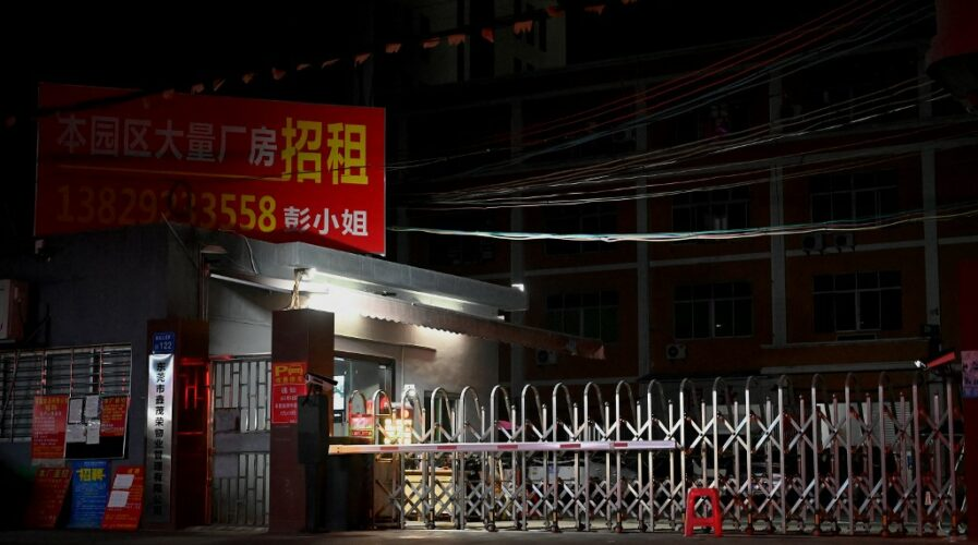 This picture shows the entrance of an industrial park in Houjie, in Dongguan China's southern Guangdong province on September 30, 2021, an area hit by power restrictions.