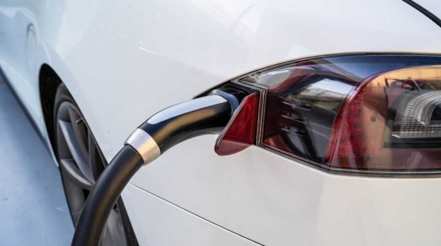 A Tesla Model X electric car is being charged at a Tesla Supercharger Station. Korea's EV battery manufacturers counts Tesla amongst its billion-dollar clients. (IMG/Shutterstock)
